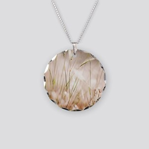 Close up of windswept grasse Necklace Circle Charm
