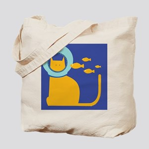 A cat wearing a helmet with fish swimming Tote Bag