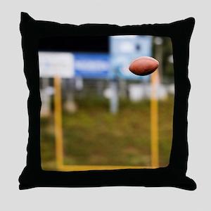 Football in Mid-Air Throw Pillow