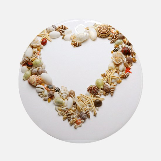 Assorted seashells form heart shape Round Ornament