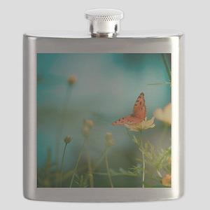 Butterfly on flower. Flask