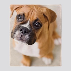 Boxer puppy looking up at camera. Throw Blanket