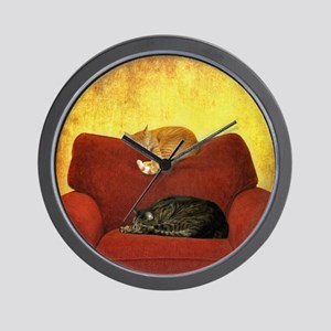 Cats sleeping on sofa. Wall Clock