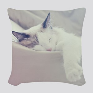 Cat sleeping on bed. Woven Throw Pillow