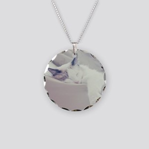 Cat sleeping on bed. Necklace Circle Charm