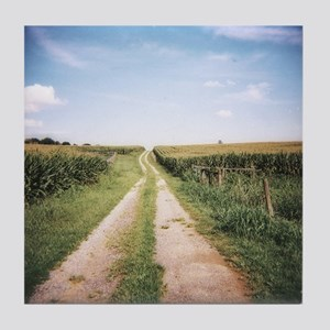 Cornfield and dirt road after harvest Tile Coaster