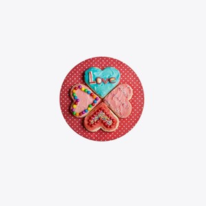 Four brightly decorated heart-shaped b Mini Button