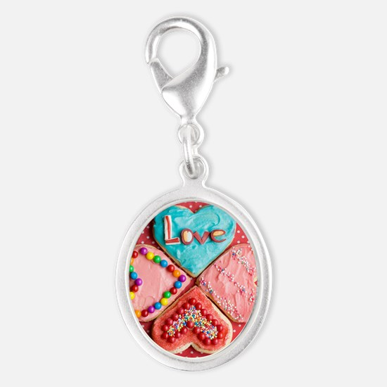 Four brightly decorated heart-s Silver Oval Charm