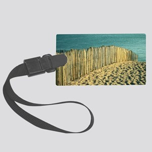 Fence in sand on beach. Large Luggage Tag