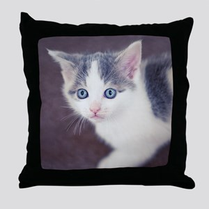 Kitten looking up with big blue eyes. Throw Pillow