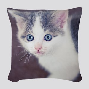 Kitten looking up with big blu Woven Throw Pillow
