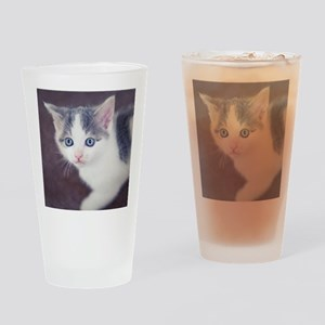 Kitten looking up with big blue eye Drinking Glass