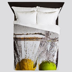 Lemon and lime falling in water. Queen Duvet