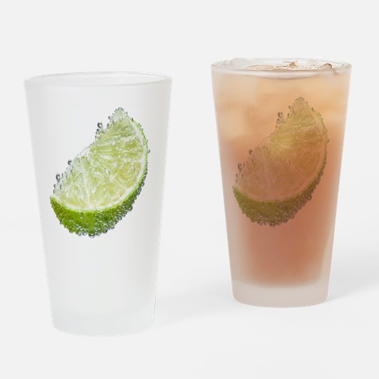 Lime wedge fruit submerged in water Drinking Glass