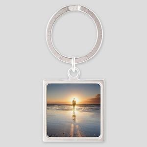 Man walking on beach at sunset, UK Square Keychain