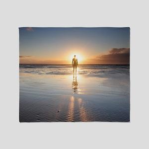 Man walking on beach at sunset, UK. Throw Blanket