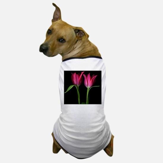 Pink tulips flowers against black back Dog T-Shirt