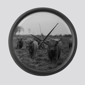 Scottish highland cattle on field Large Wall Clock