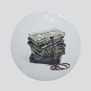 Pile of unwound cassette tapes Round Ornament