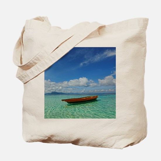 Small boat floating on the clear shallows Tote Bag