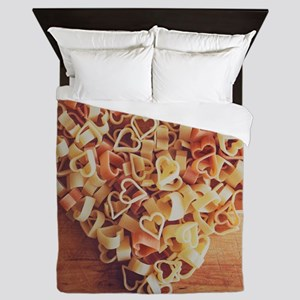 Uncooked heart-shaped pasta on wooden  Queen Duvet