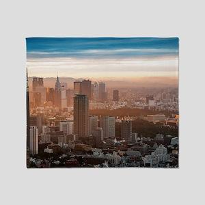 Smog settles over the Tokyo skyline  Throw Blanket