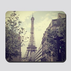 The Eiffel tower surrounded by the stree Mousepad