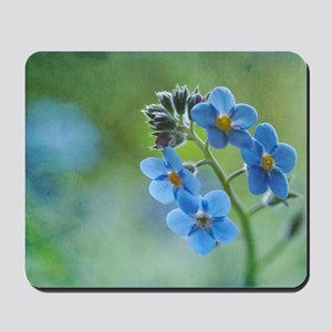 Tiny blue forget-me-not flowers. Mousepad