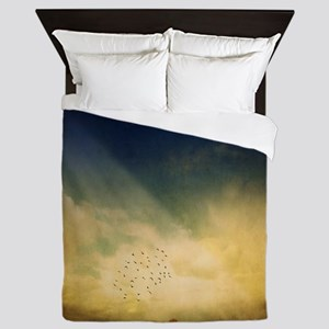 The trees, birds and light play in the Queen Duvet