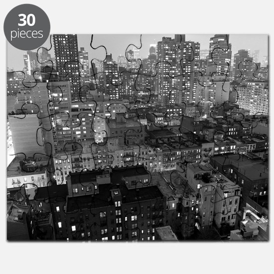 View of New York City buildings at night. Puzzle