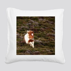 Young pony running downhill t Square Canvas Pillow