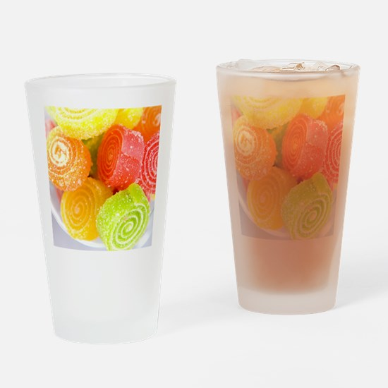 Colorful fruit sugary candies close Drinking Glass