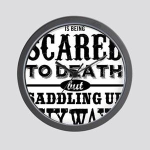 Courage is being scared to death but sa Wall Clock