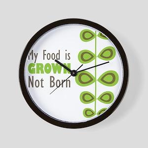 my food is grown not born Wall Clock
