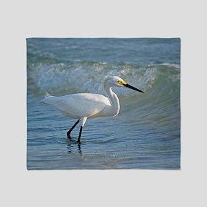 Snowy egret on the beach Throw Blanket