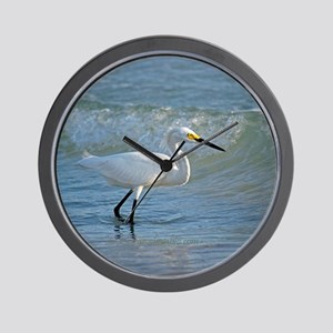 Snowy egret on the beach Wall Clock