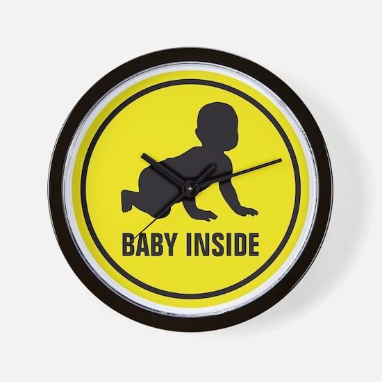 baby inside Wall Clock
