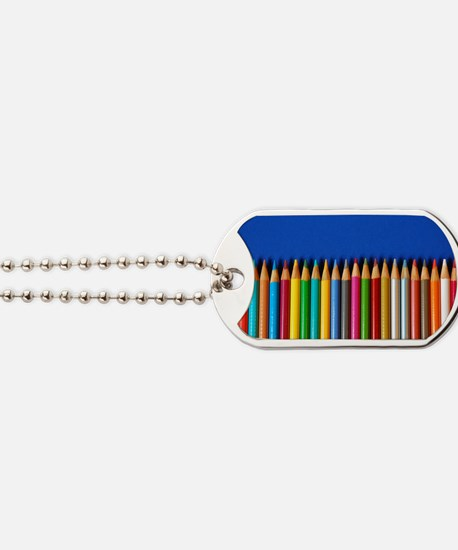 Colorful pencil crayons on blue backgroun Dog Tags