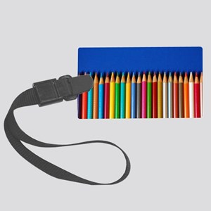 Colorful pencil crayons on blue  Large Luggage Tag