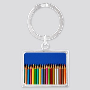 Colorful pencil crayons on blue Landscape Keychain
