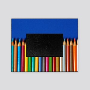 Colorful pencil crayons on blue back Picture Frame