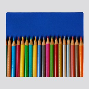 Colorful pencil crayons on blue back Throw Blanket
