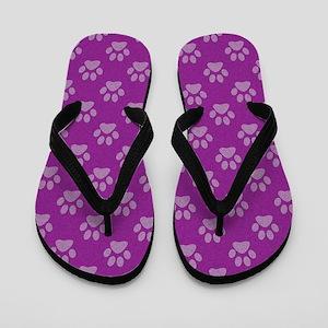 d4fdb5a7ef734 Puppy paw prints on purple background Flip Flops