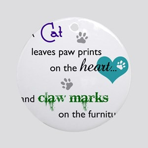 A cat leaves paw prints... Round Ornament