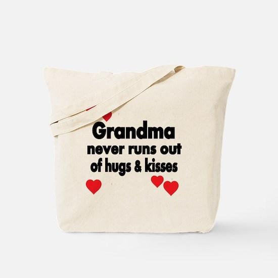 GRANDMA  NEVER RUNS  OUT OF HUGS  KISSES Tote Bag