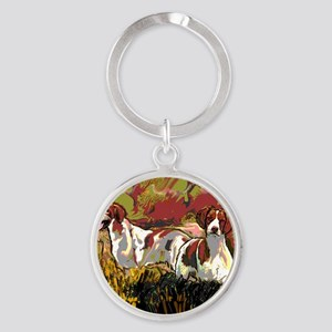 Brittany spaniels in the field Round Keychain