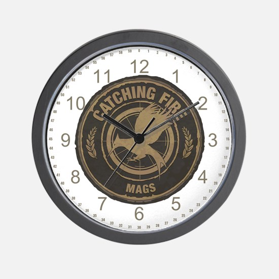 Catching Fire Mags Wall Clock