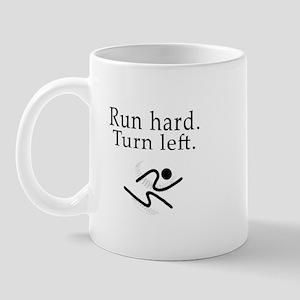 the small run hard. turn left. mug