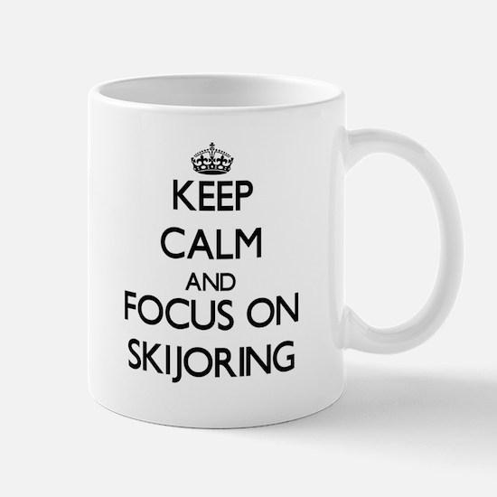 Keep calm and focus on Skijoring Mugs