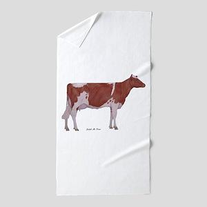 Golden Guernsey cow Beach Towel